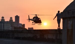 Cubans look at one of the helicopters from Universal Studios of Hollywood used during the shooting of Fast & Furious 8 in Havana, on April 28, 2016.  / AFP PHOTO / ADALBERTO ROQUE